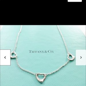 Tiffany three heart necklace. Not new.
